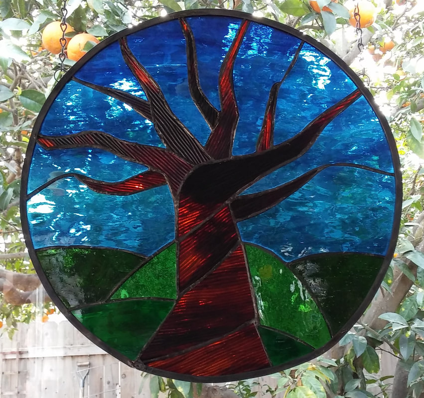 Bare tree of life, circular stained glass