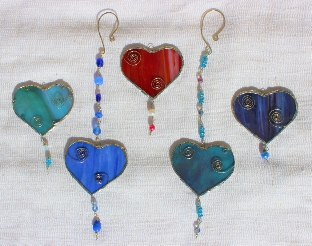Blue heart with spirals and pearl