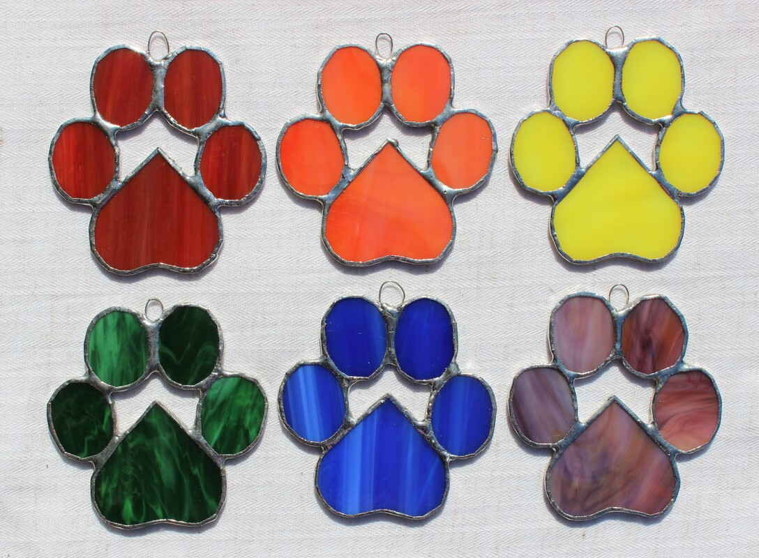 Group of 6 brightly-colored pawprints